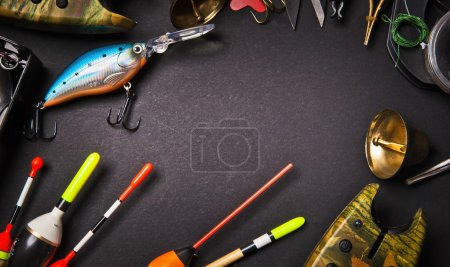 Photo for Fishing tackle on dark background - Royalty Free Image