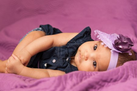 Adorable little african american baby girl looking - Black peopl