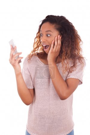 Ecstatic young African American woman making a phone call on her