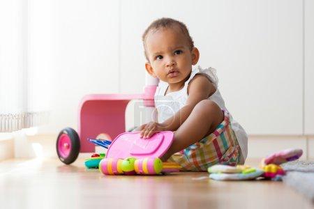 little African American little girl sitting