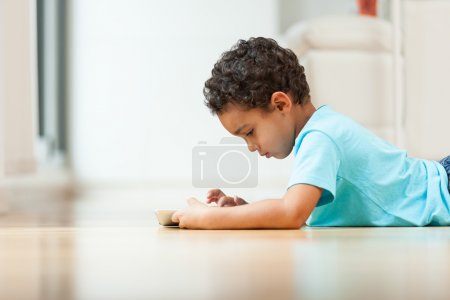 African american little boy using a tactile tablet