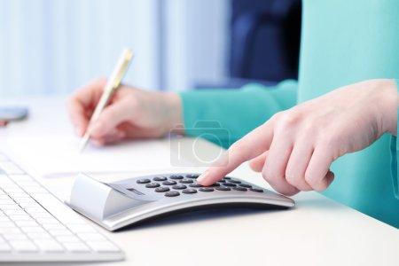 Businesswoman working on financial plan