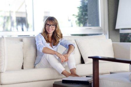 Woman relaxing at beautiful living room