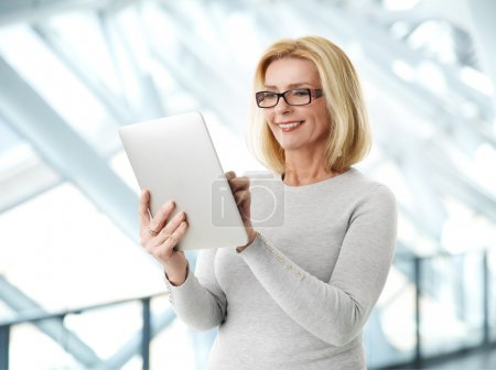 Active business woman with tablet