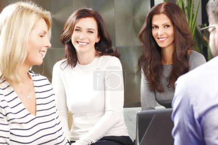 Photo for Efficiency business people sitting at conference. Portrait of middle age businesswomen sitting at office  while consulting from financial plan. - Royalty Free Image