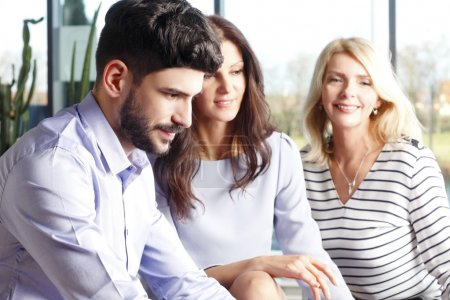 Businesswomen and businessman consulting