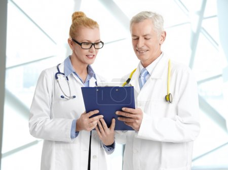 Doctors analyzing medical test results
