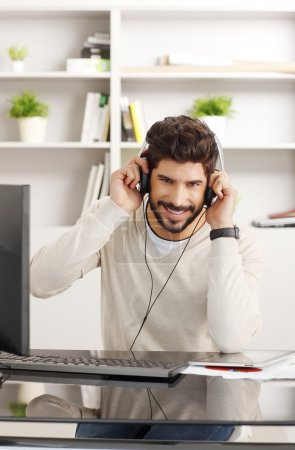 Funny man listening music