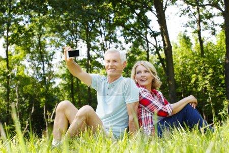 Happy senior couple taking self portrait