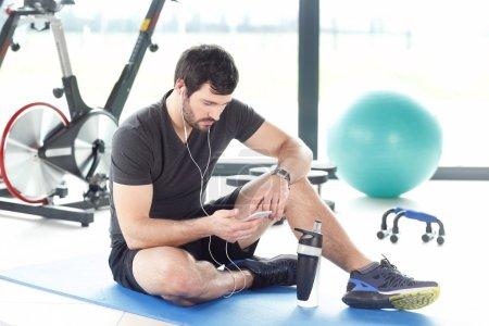Fitness instructor taking break after workout