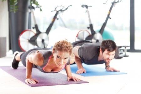 Fitness instructors doing push ups