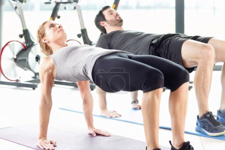 Woman and a man training together