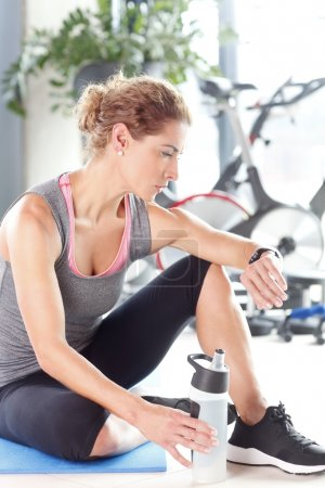 Woman taking a break after fitness workout