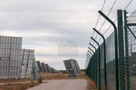 Field of solar panels gathering energy