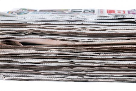 Stacked pile of newspapers