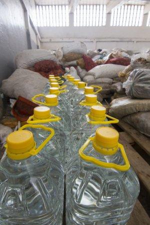 Transparent plastic bottle with aguardiente (alcoholic beverage)