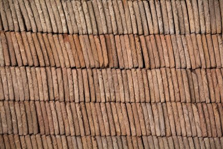 pile of traditional mud bricks production