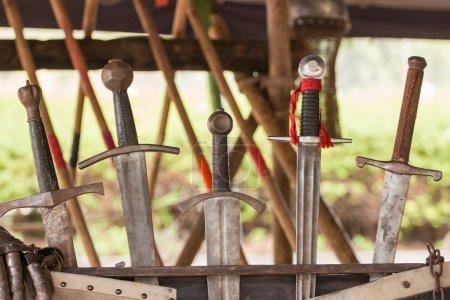 row of medieval swords