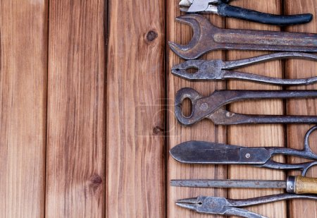 Photo for Top view of old working tools on wooden background with place for your text. - Royalty Free Image