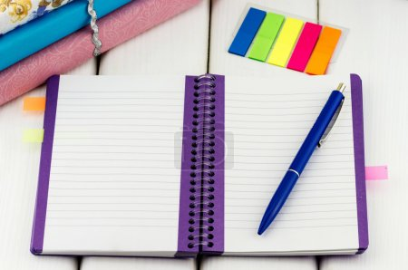 Notebook with pen and colorful stickers