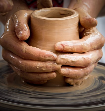 Master working on pottery wheel