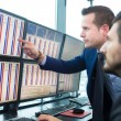 Businessmen trading stocks. Stock traders looking ...