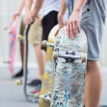 Boys skateboarding on street Urban