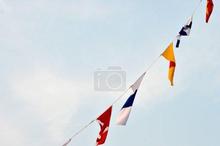 Maritime flags against blue sky