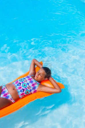 Girl relaxing in a pool