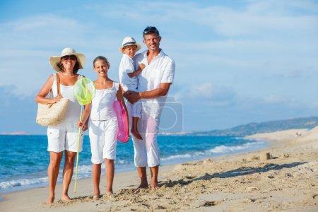 Family on tropical beach