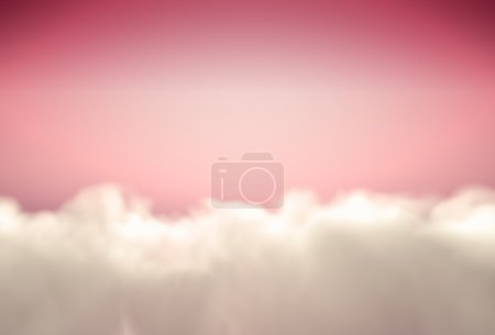 Beautiful fluffy clouds at pink sky