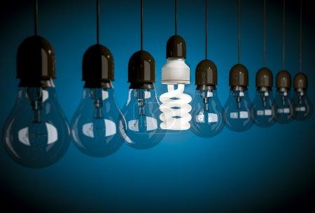 Photo pour Rangée d'ampoules incandescentes avec une ampoule à économie d'énergie - image libre de droit