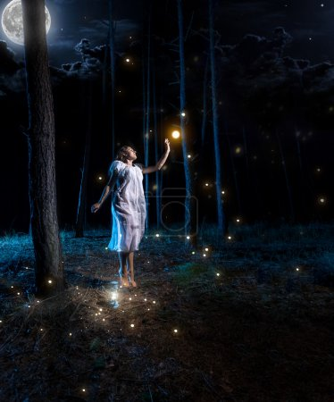 young woman at night forest