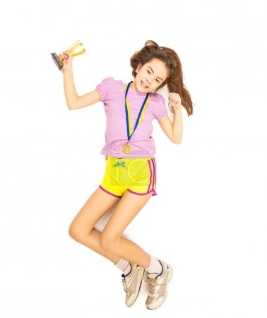 Isolated shot of happy girl jumping with trophy cup and gold med