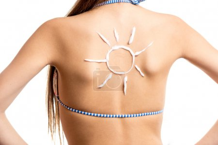 isolated shot of sun drawn by sun lotion on girls back