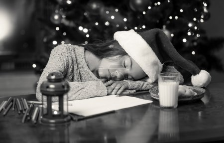 monochrome portrait of cute girl fell asleep while writing lette