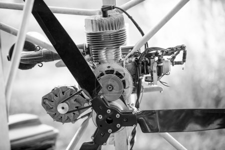 black and white photo of paraglider engine and propeller
