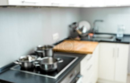 Photo for Blurred background of modern kitchen at home with electric oven - Royalty Free Image