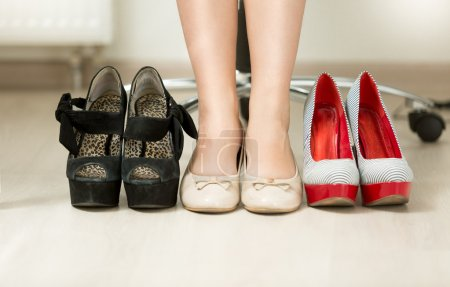 Photo for Closeup conceptual photo of woman choosing most comfortable shoes - Royalty Free Image