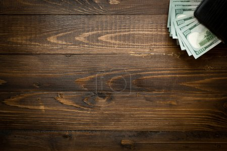 Background of money in purse on wood with copyspace