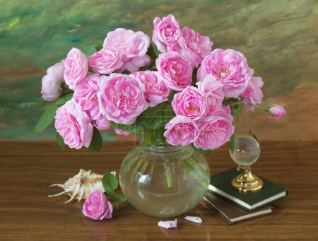 Still life with roses flowers, books, globe and sea shell on artistic background