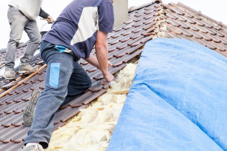 roofers laying tile