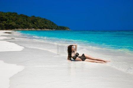 Beautiful sexy bikini girl model sun tanned On Tropical Beach. O