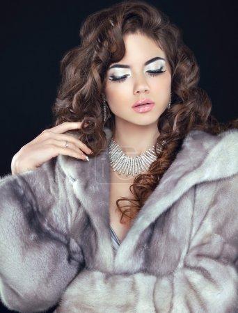 Beauty Fashion Model Woman in Mink Fur Coat. Winter Brunette Gir
