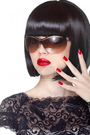 Photo for Makeup and manicured polish nails. Fashion brunette woman wearing in sunglasses isolated on white background. Professional model. - Royalty Free Image