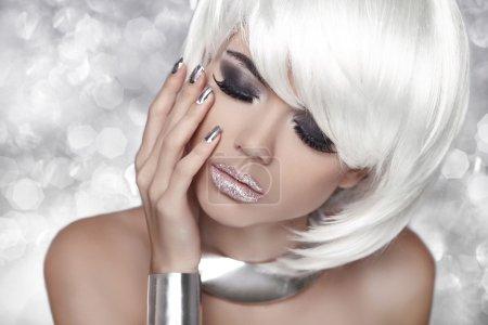 Fashion Blond Girl. Smoky Eye makeup. Beauty Portrait Woman over