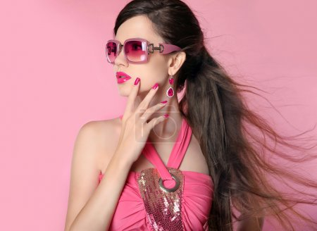 Beauty fashion model girl in sunglasses with bright makeup, long