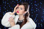 Beauty Fashion Model Girl in white mink Fur Coat. Makeup. Beauti