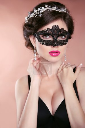 Beautiful hot girl model with mask. Makeup. Hairstyle. Jewelry.