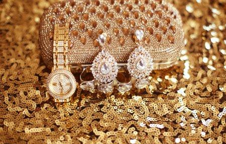 Fashion diamond earrings and golden wristwatch, womens accessori